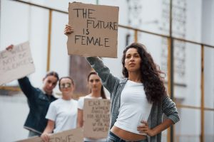 Strong woman. Group of feminist girls have protest for their rights outdoors